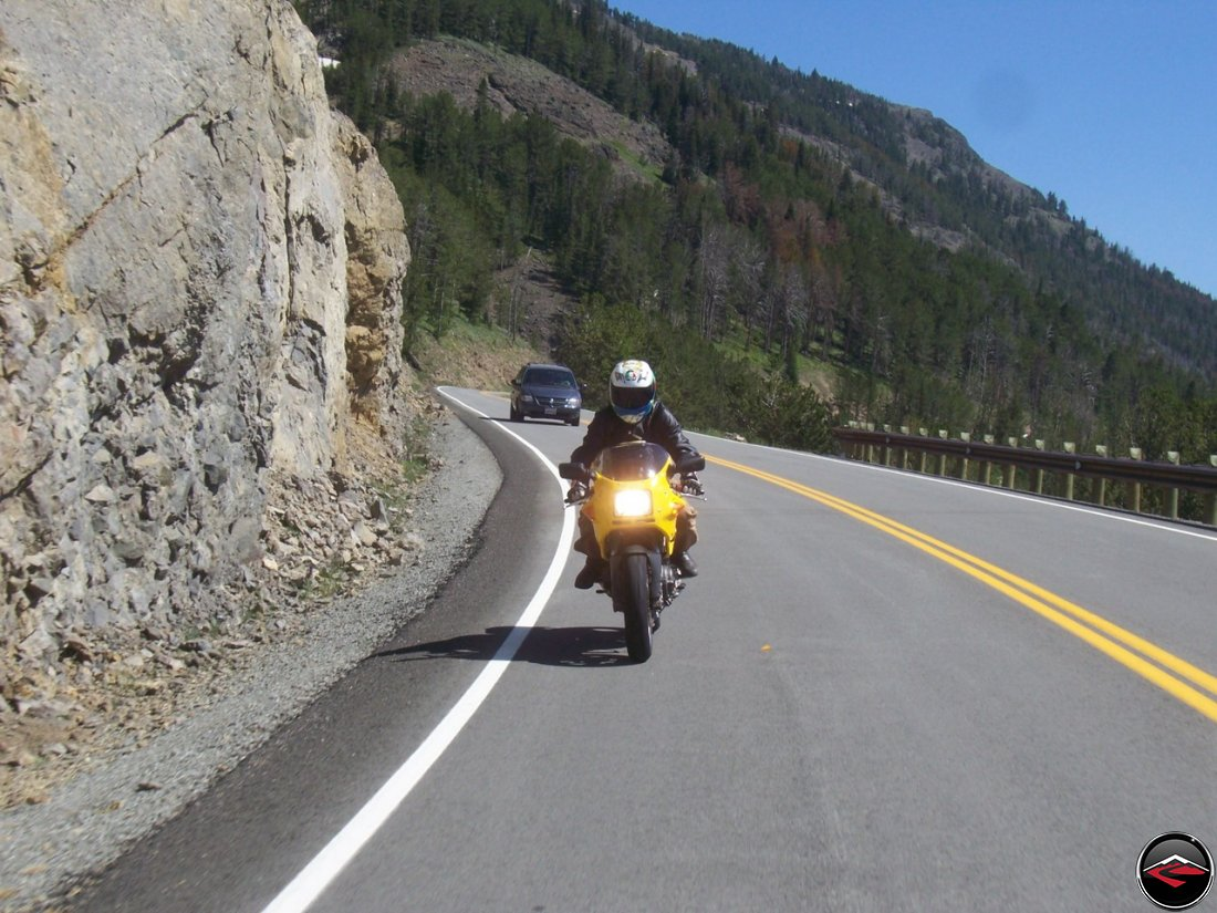 Motorcycle on twisty mountain road, Dunraven Pass in Yellowstone National Park