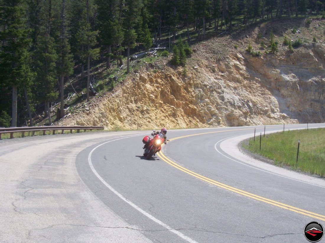 motorcycle riding through a switchback corner