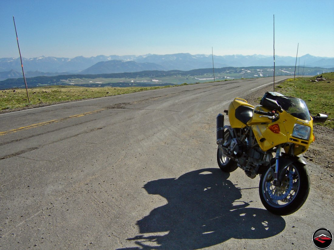 Yellow Ducati 900 SuperSport on the top of a mountain