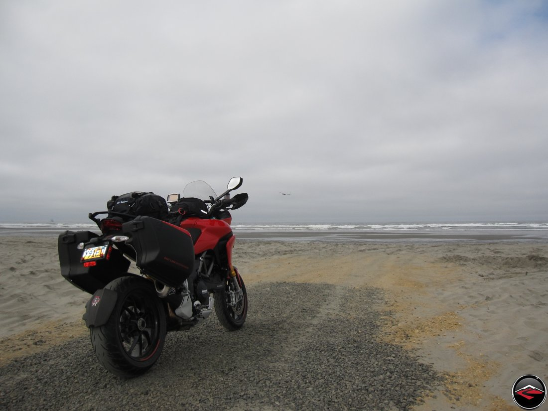 2012 Red Ducati Multistrada 1200 S Touring with luggage parked on the beach