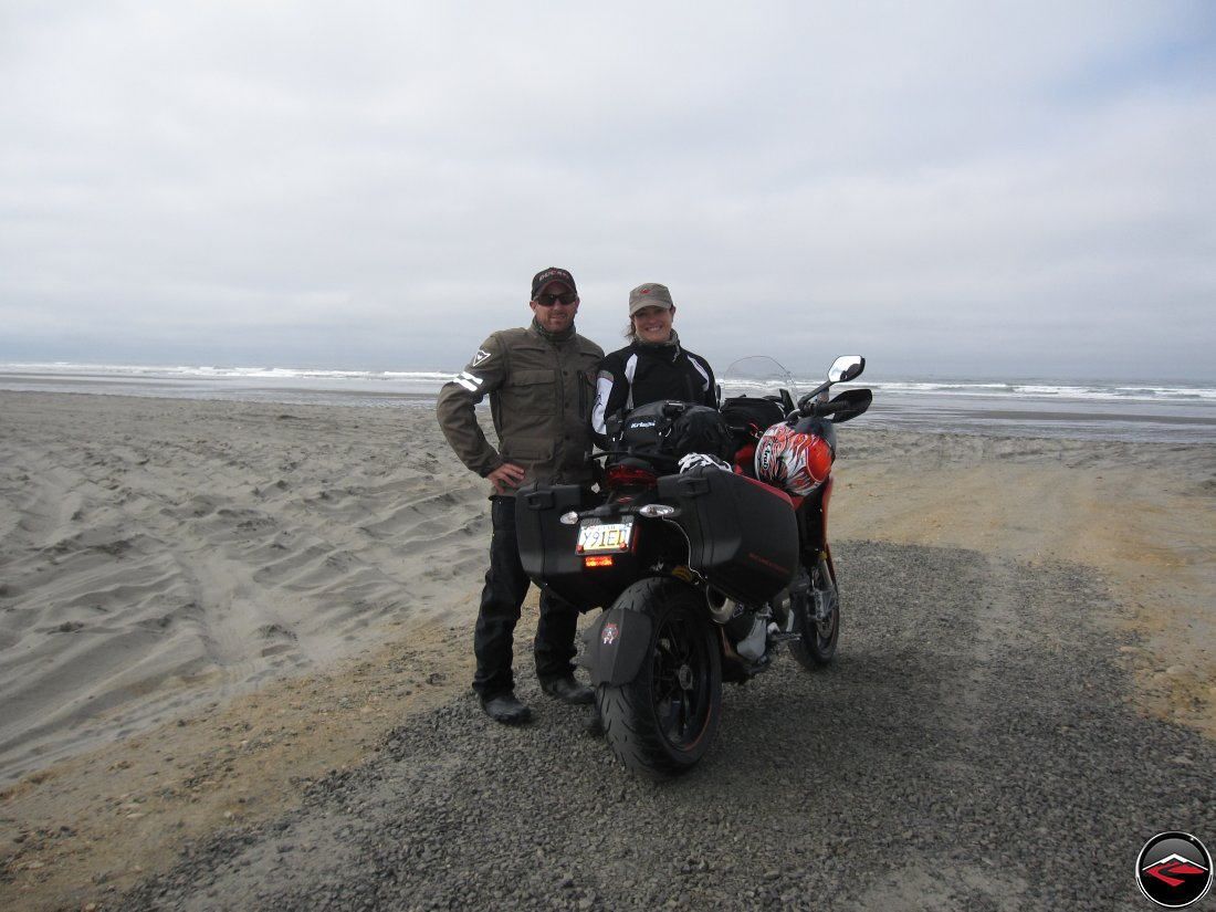 Ducati Motorcycle Riders with Multistrada parked on the beach portrait