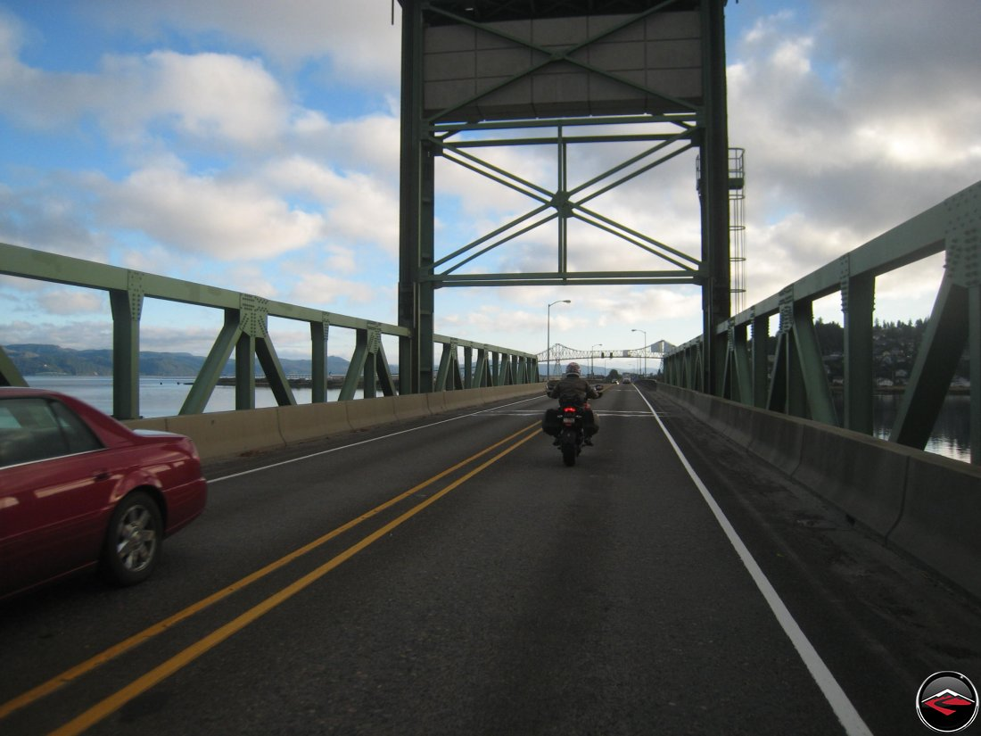 Motorcyclist riding into Astoria, Oregon
