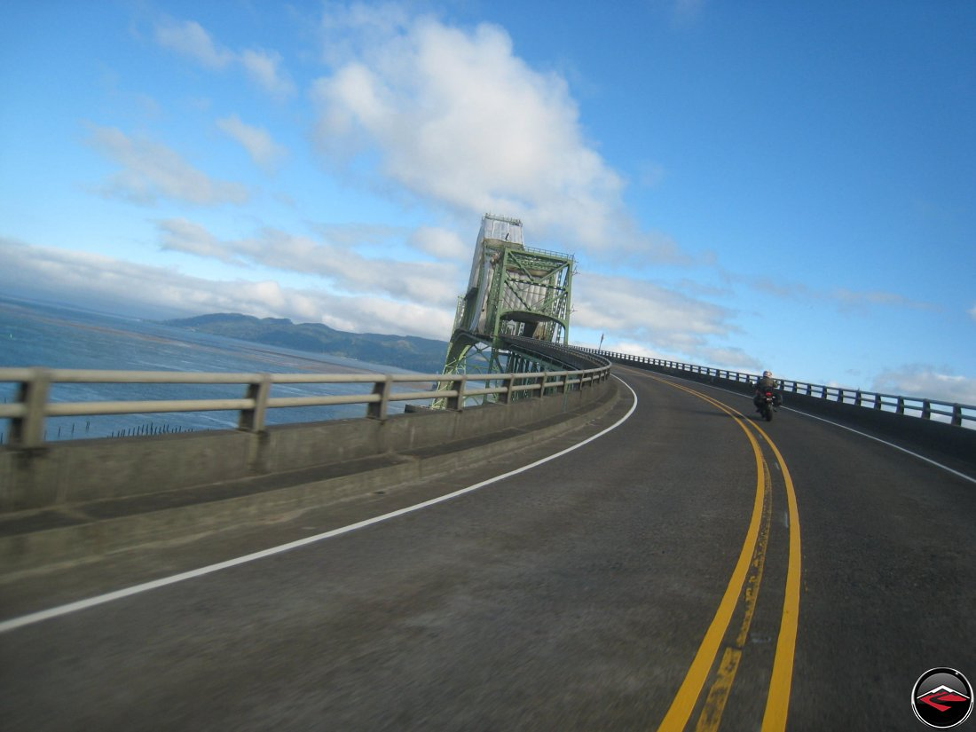 Riding a ducati motorcycle over the Meigler Bridge in Astoria, Oregon