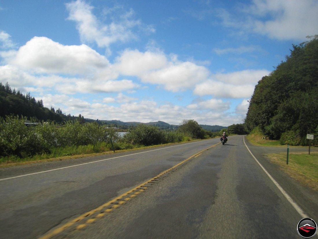Motorcycle riding along washington highway 101 along the pacific coast