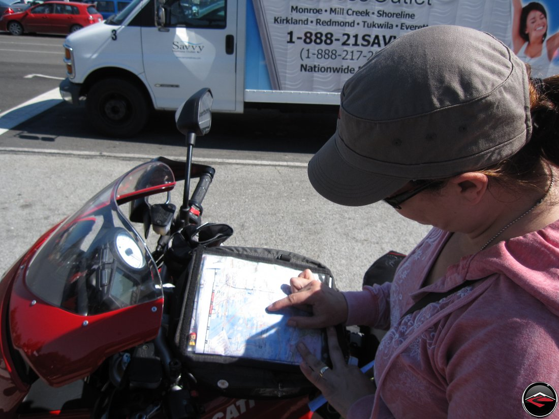 Looking at map in a motorcycle tank bag
