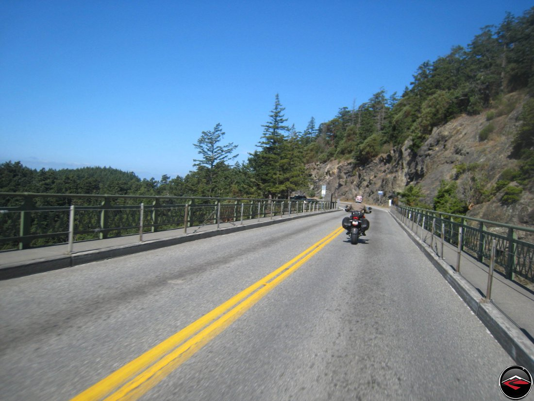 motorcyle riding over deception pass bridge