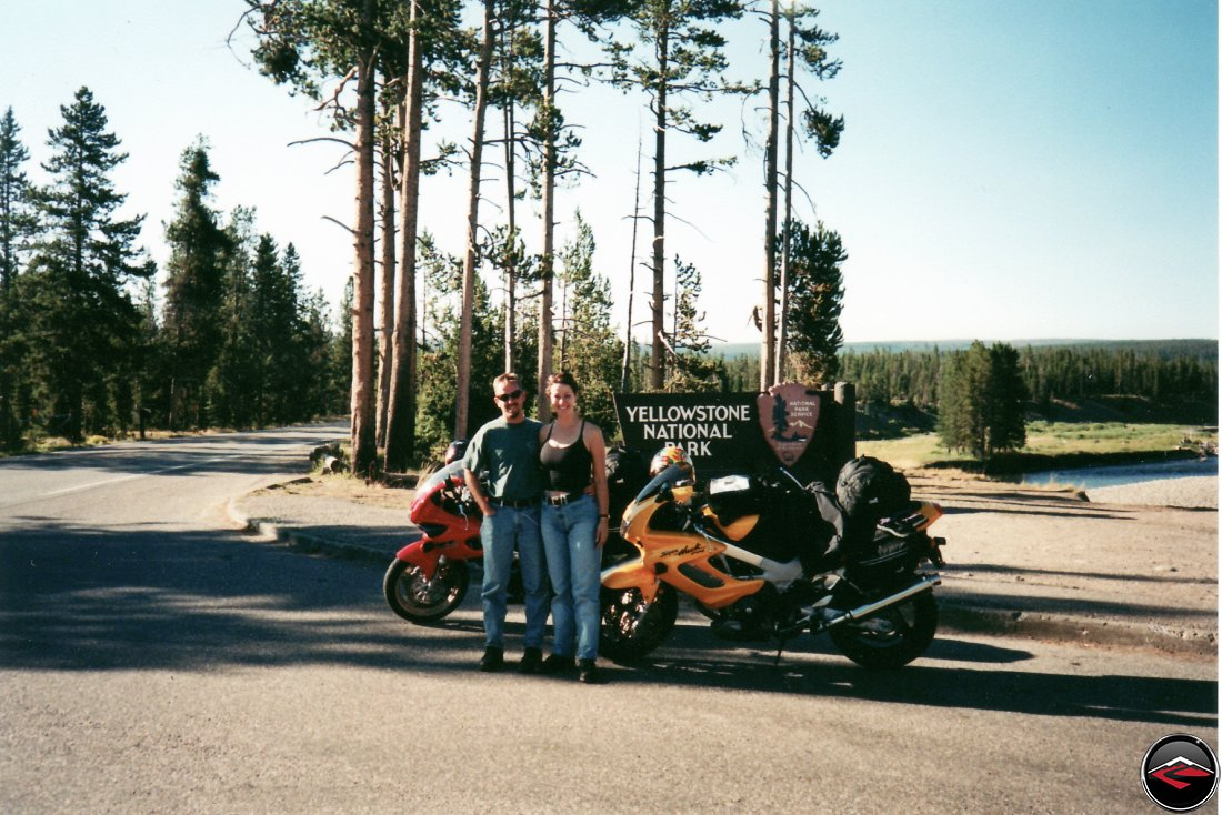 TL1000S and Honda Superhawk motorcycles at the Welcome to Yellowstone National Park sign