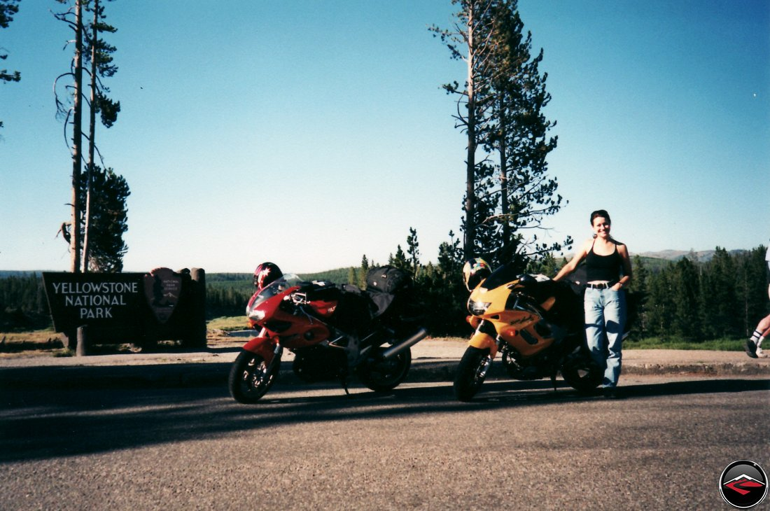 TL1000S and Honda Superhawk motorcycles and a sexy girl at the entering yellowstone national park sign
