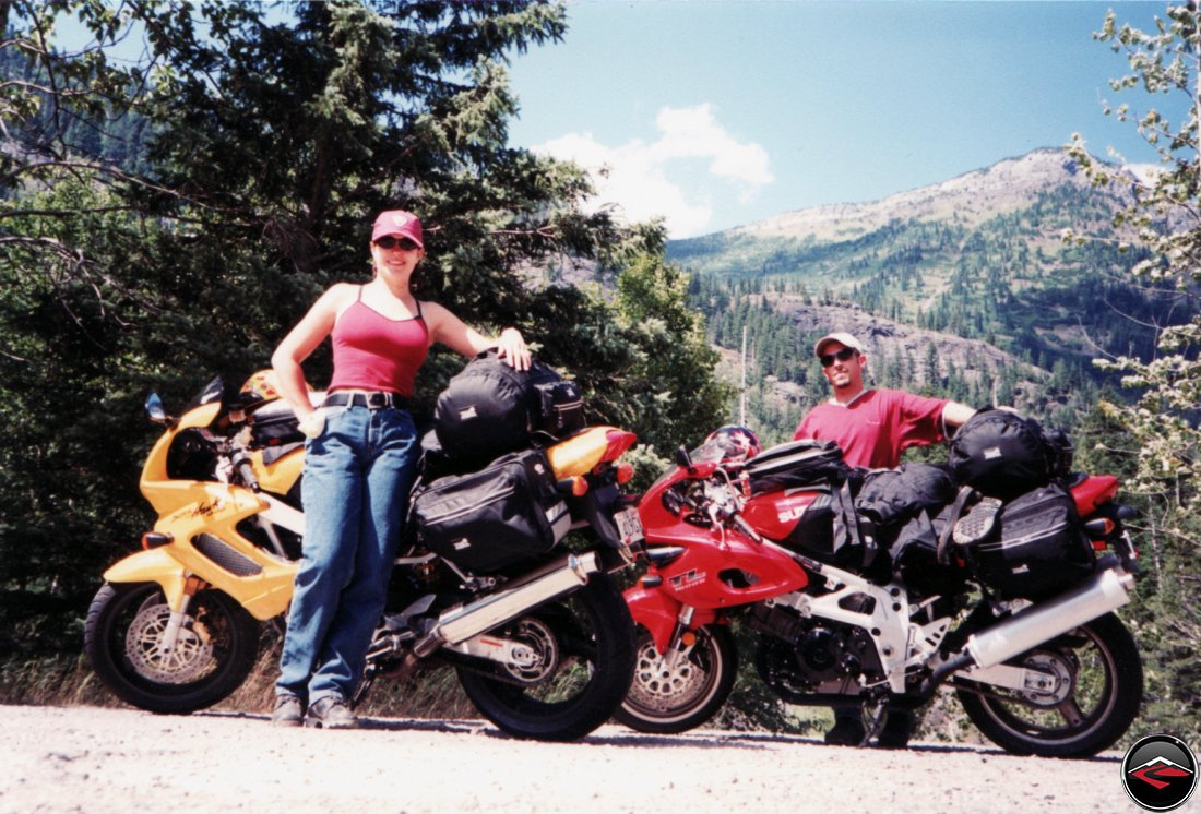 sexy girl and TL1000S and Honda Superhawk motorcycles taking a quick break on avalanche river