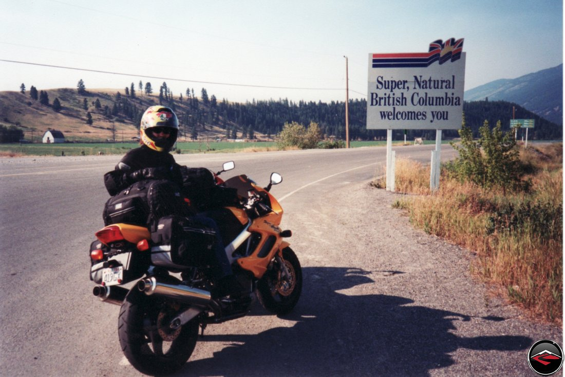 Honda Superhawk motorcycle entering British Columbia canada at the Roosvill border sign Welcome to Canada