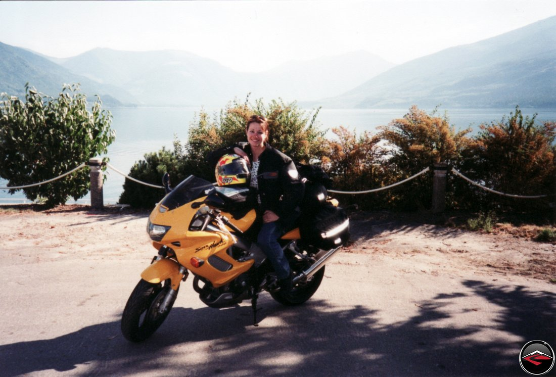 super pretty and sexy girl kris sitting on her yellow honda vtr1000 superhawk in nakusp british columbia