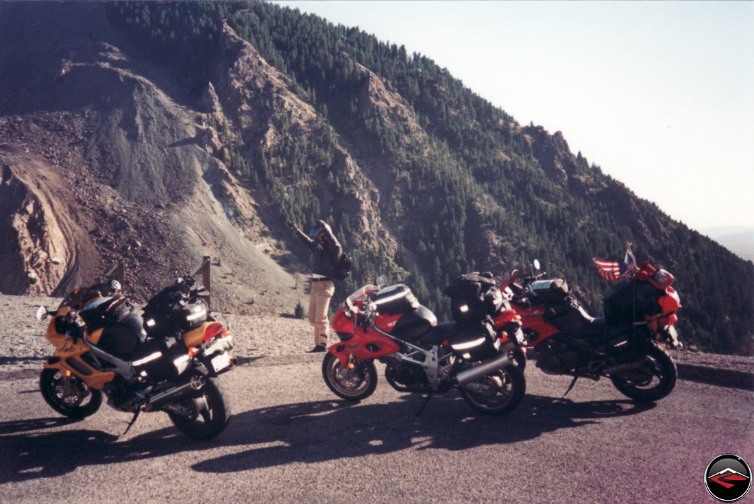 on top of a mountain with Suzuki TL1000S and Honda Superhawk and Yamaha TDM850 motorcycles