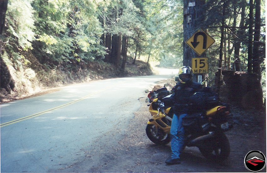 Pretty girl riding her Yellow Honda Superhawk VTR1000 on Fantastic California B-Roads
