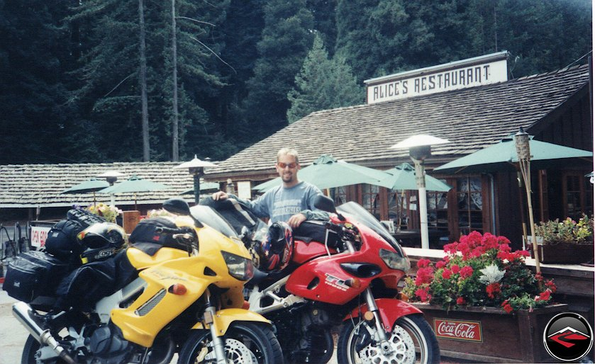 Man standing behind Yellow Honda VTR10000 Superhawk and Suzuki TL1000S at Alices Retaurant on Skyline Boulevard in Northern California