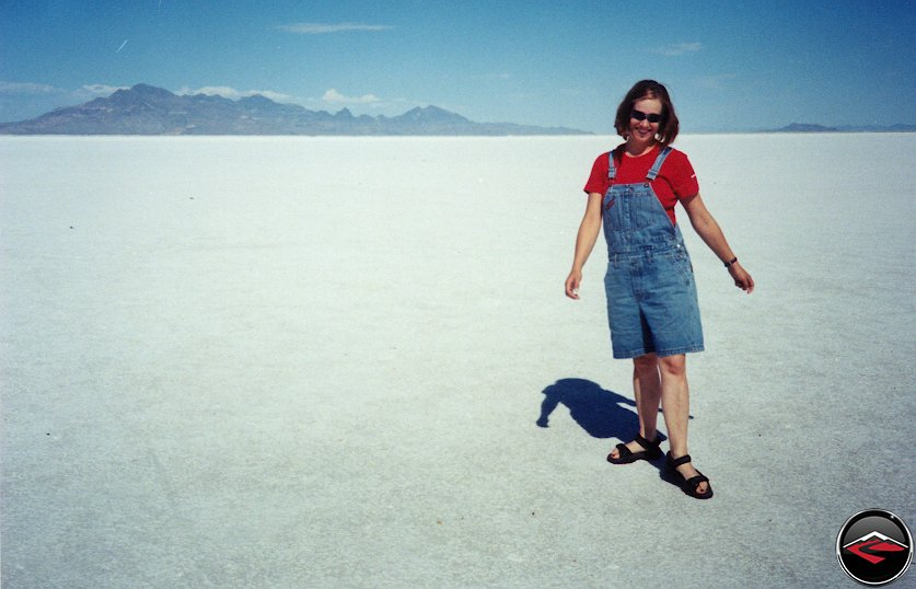 pretty girl standing on the bonneville salt flats