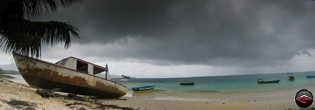 Grace A Dios old fishing boat and storm clouds in the caribbean