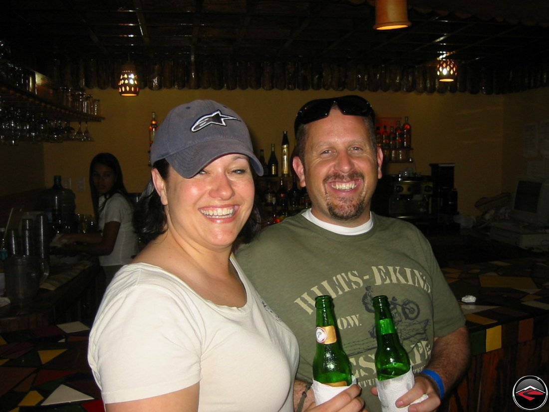 man and woman drinking presidente beer
