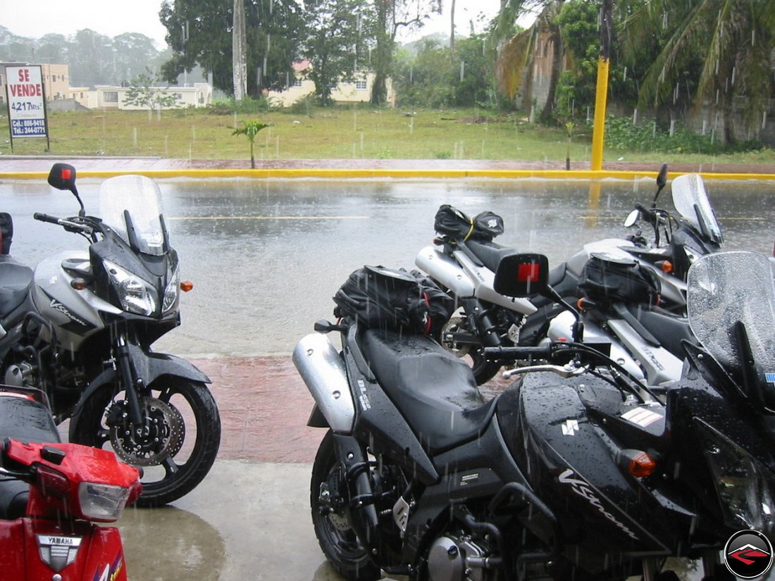 heavy tropical rains fall on suzuki v-strom 650 morocycles