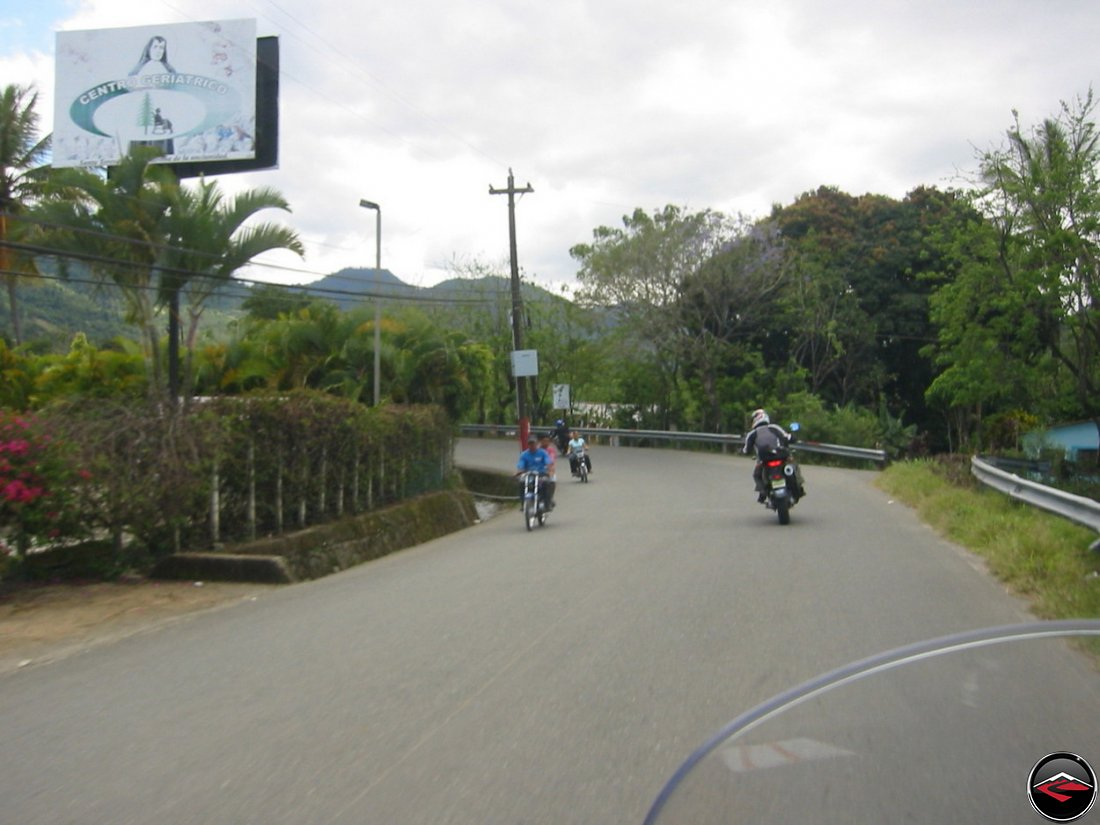 riding a motorcycle around a corner in the Dominican Republic