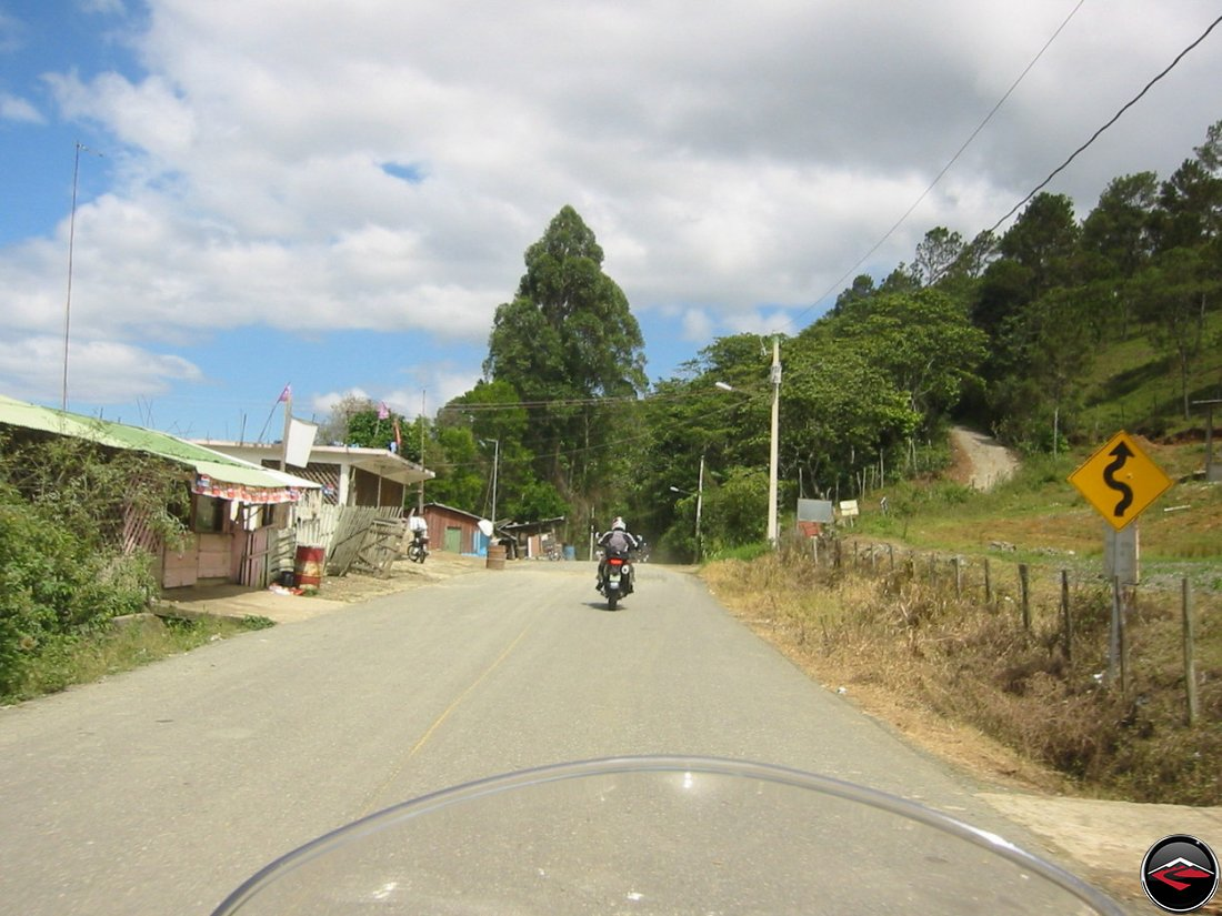 Motorcycles riding through gravel patches in the Dominican Republic