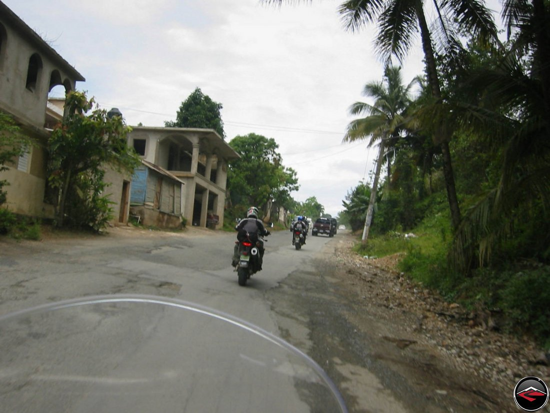 riding a motorcycle over a patchy road in samana dominican republic