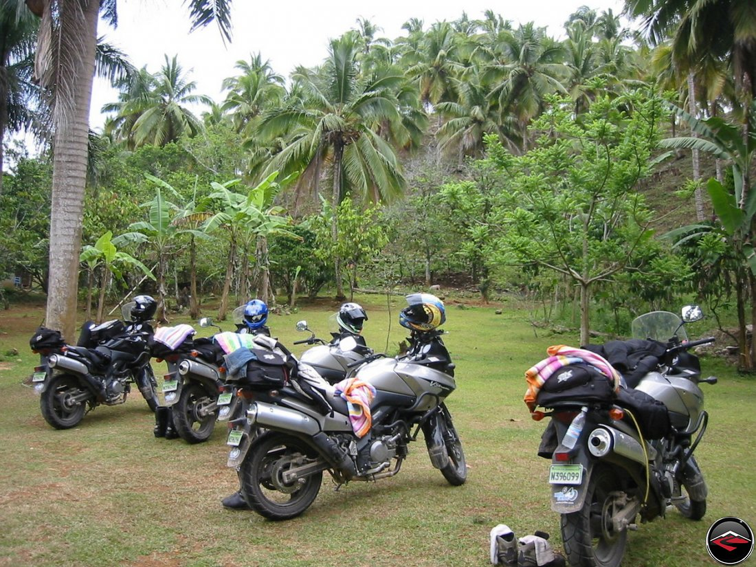 motorcycles parked on the grass in Cascada El Limon Dominican Republic