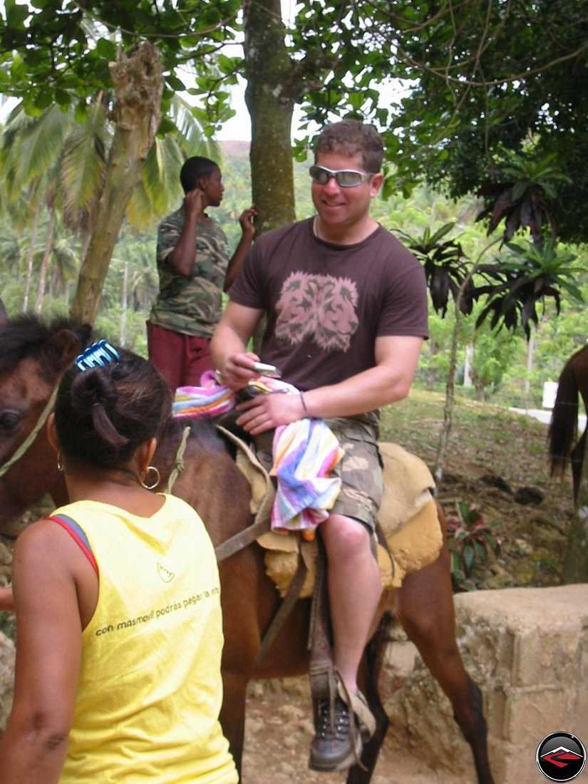 man flirting with local girls in Cascada El Limon Dominican Republic