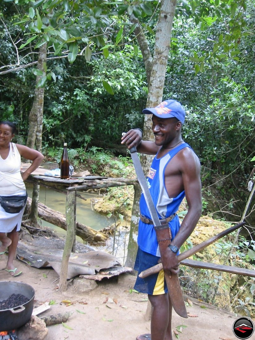 man shows his machete at Cascada El Limon Dominican Republic