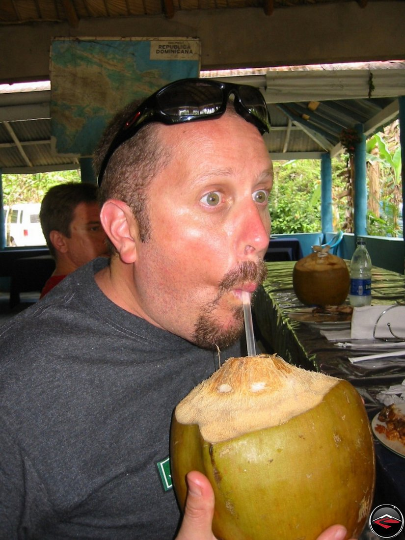 drinking coconut milk out of a coconut at Cascada El Limon Dominican Republic