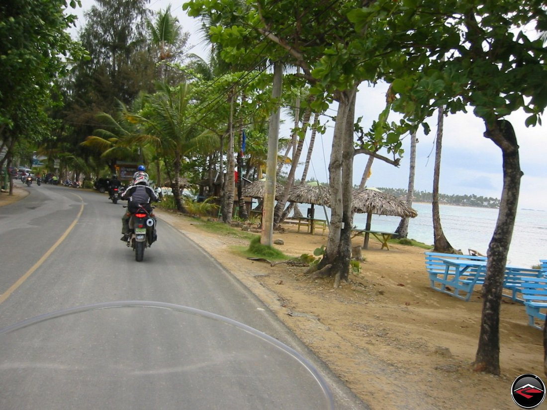 riding a motorcycle along the beach in Las Terrenas El Limon Samana Dominican Republic