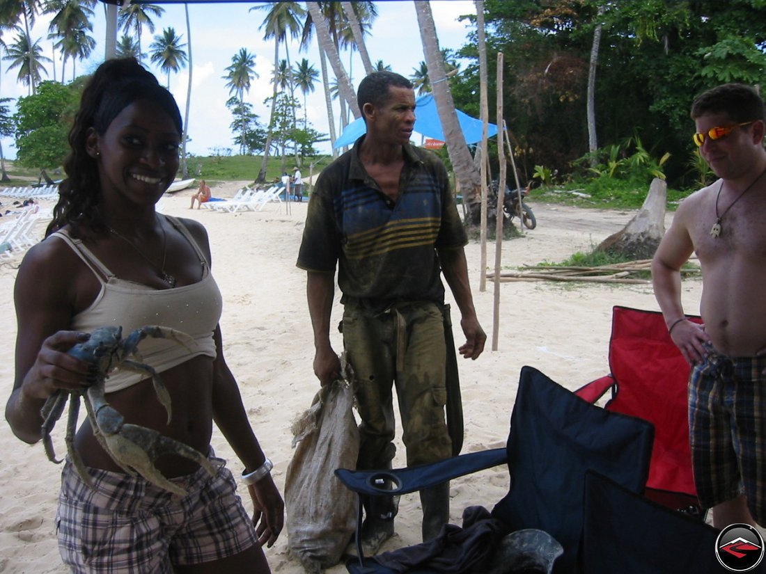 Woman selling a crab at playa rincon dominican republic