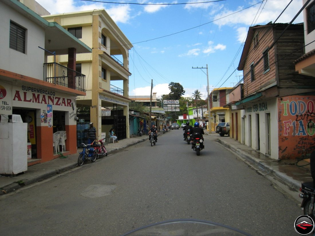 Motorcycles riding through downtown Jarabacoa