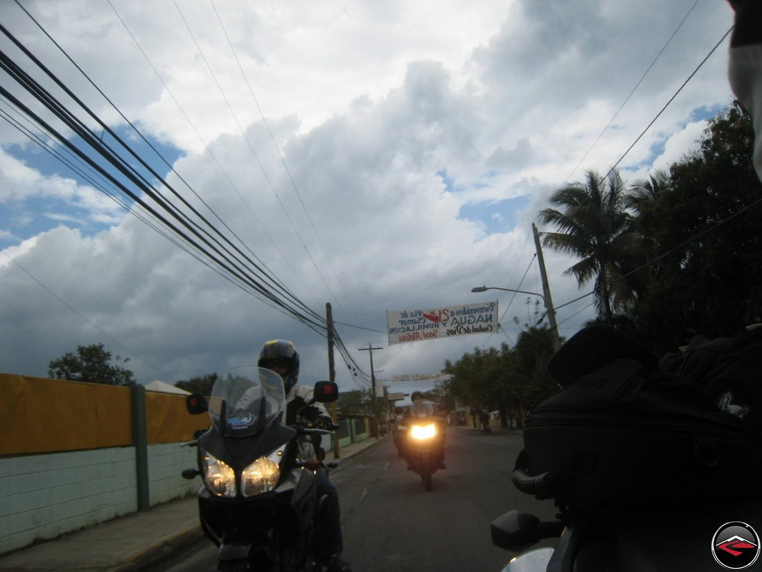 motorcycles ride in the caribbean with dark clouds on the horizon