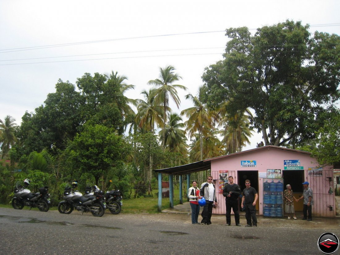 small, pink, roadside convienence store along the road in the caribbean