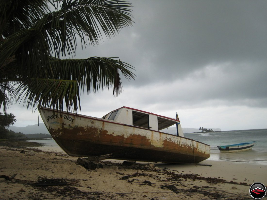 Grace A Dios fishing boat stranded on a caribbean beach