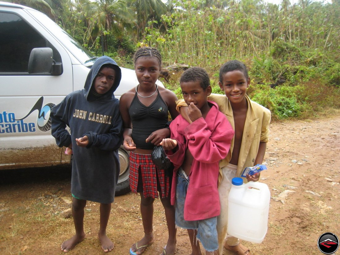 caribbean children share a bag of peanuts