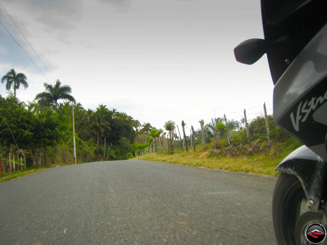 Motorcycle riding down a perfect road in Samana Dominican Republic