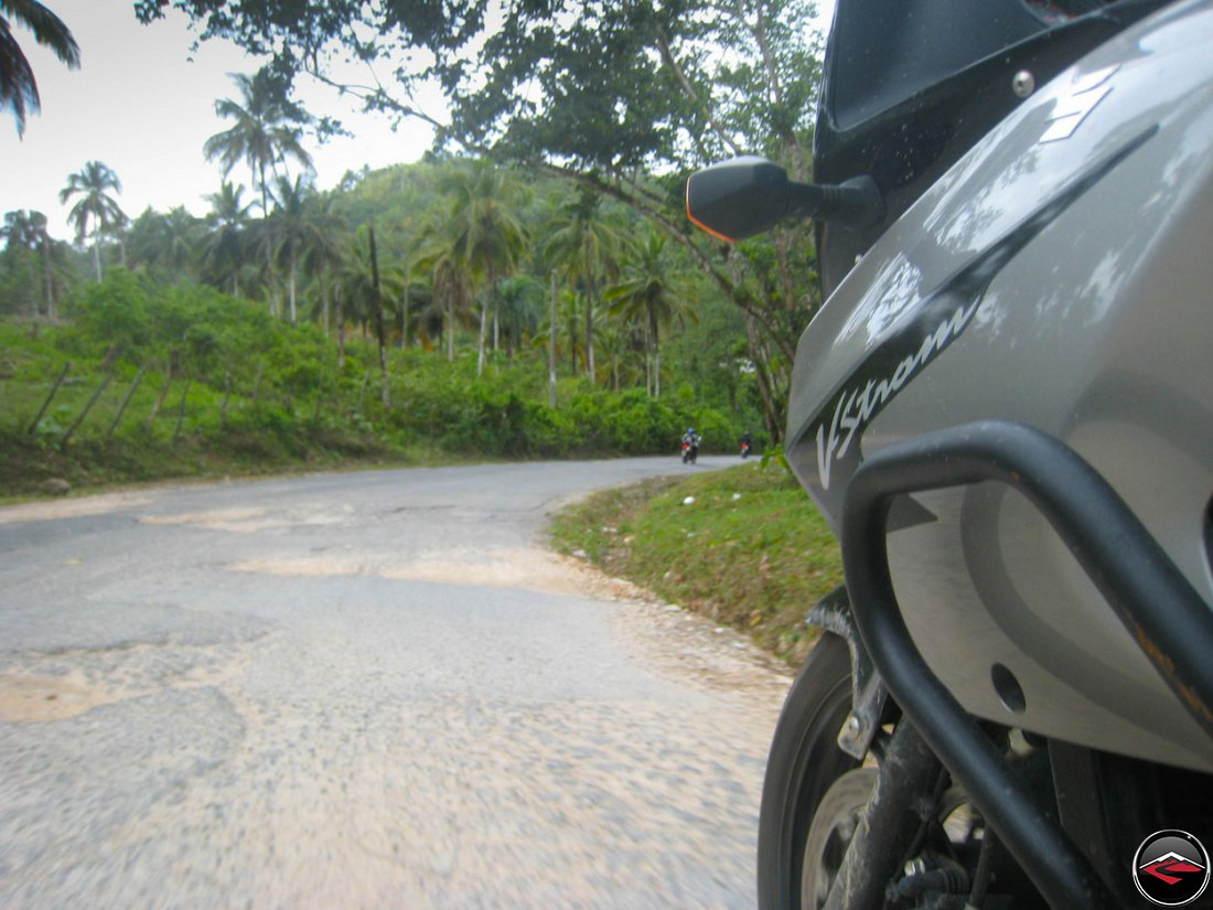 VStrom 650 Motorycle riding through rough asphalt in El Limon Samana Dominican Republic