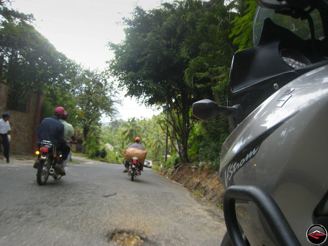 Bikes of burden motorcycles hauling bags of vegetables in El Limon Samana Dominican Republic