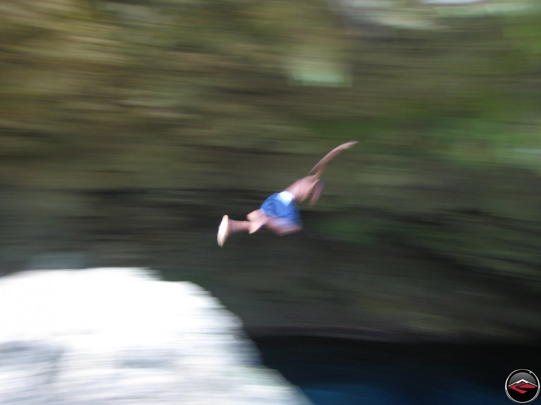 local boy Jumping into water in the dominican republic