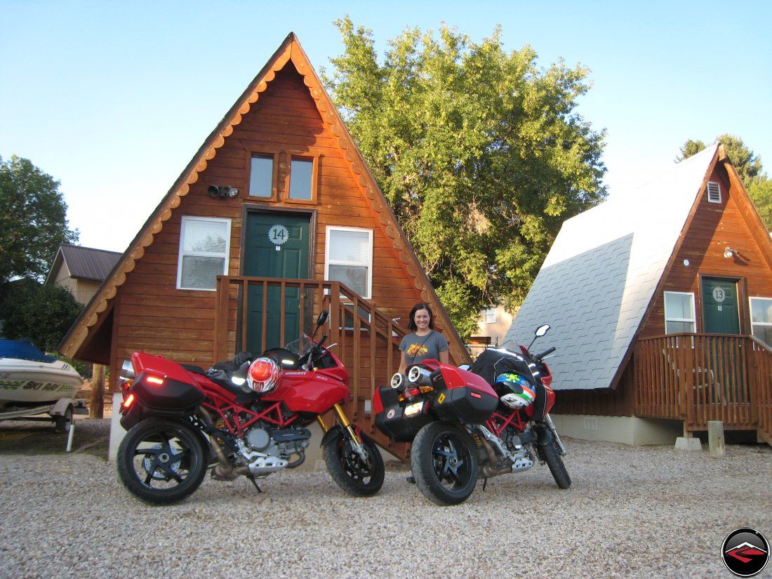 Two Ducati Multistrada motorcycles parked in front of Camper cabins in Hulett Wyoming