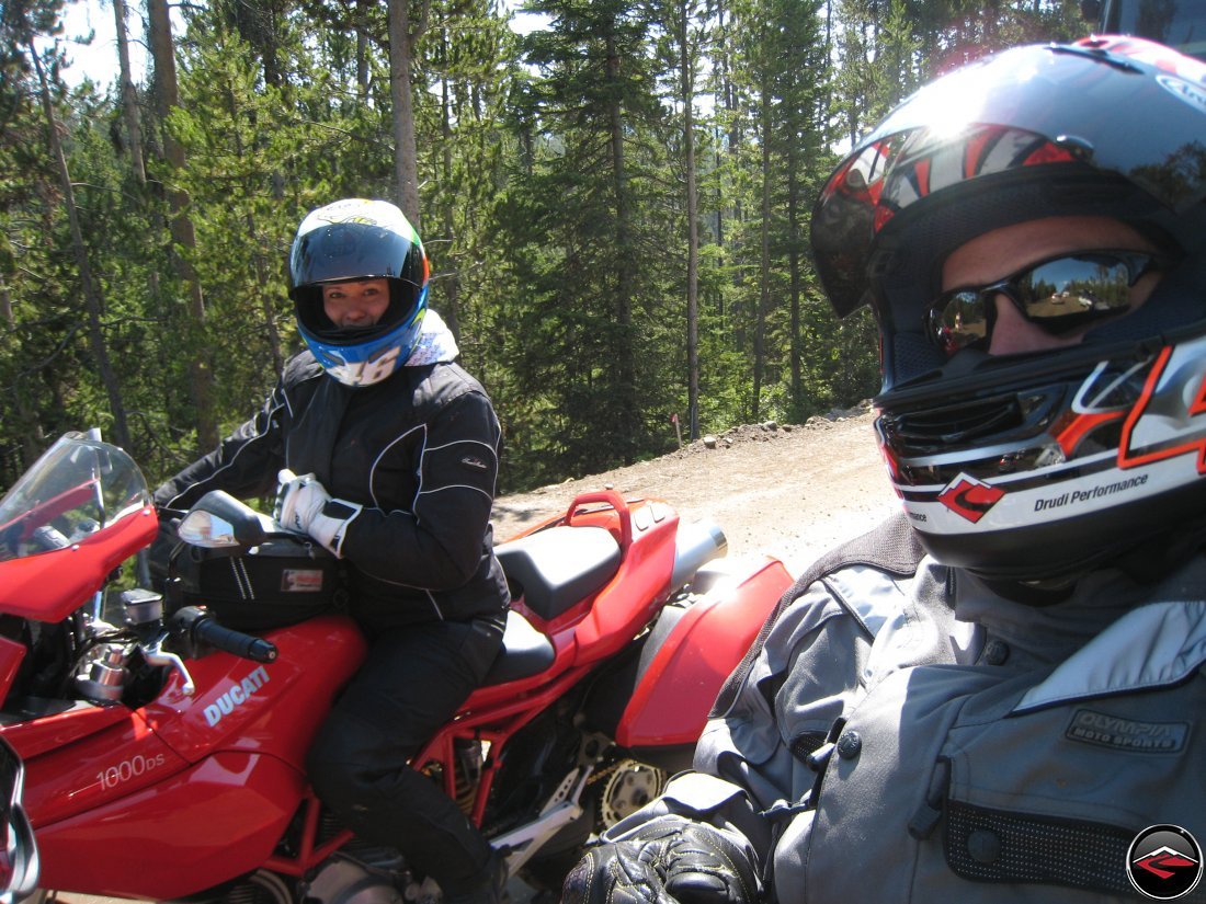 Man and a woman riding through Yellowstone National Park on Ducatis