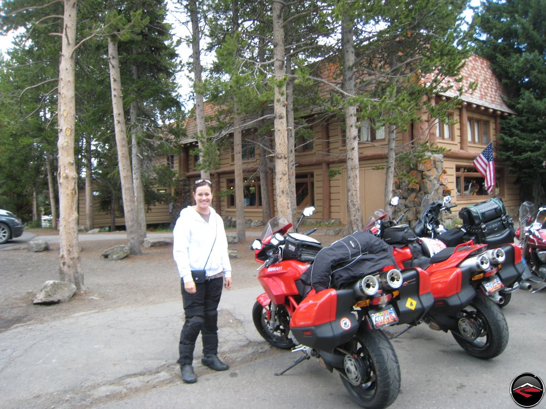 pretty woman at fishing bridge in Yellowstone National Park, standing next to parked motorcycles