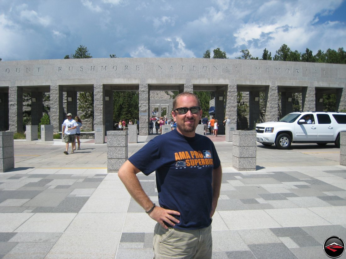Staning in front of the Mount Rushmore National Monument Entrance
