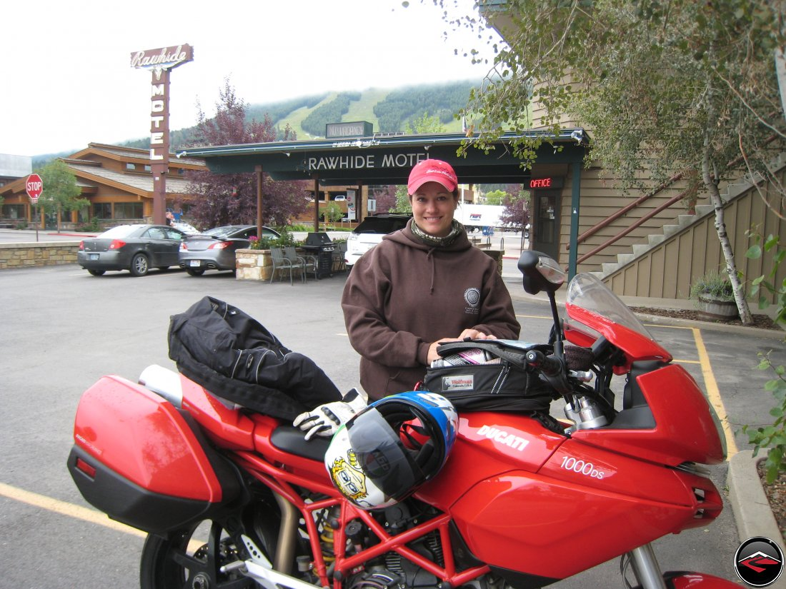 Pretty Girl standing behind her Ducati Multistrada Motorcycle at the Rawhide Motel in Jackson Holy, Wyoming