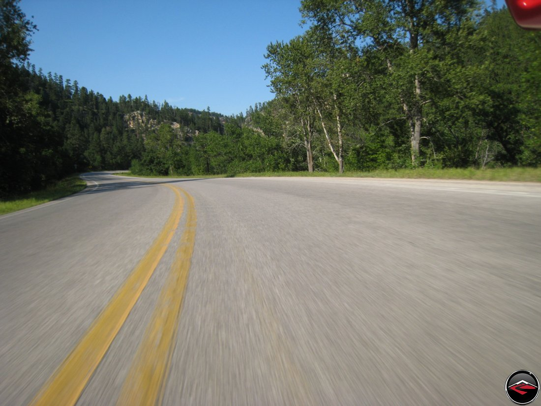 riding a ducati multistrada motorcycle through the black hills of South Dakota