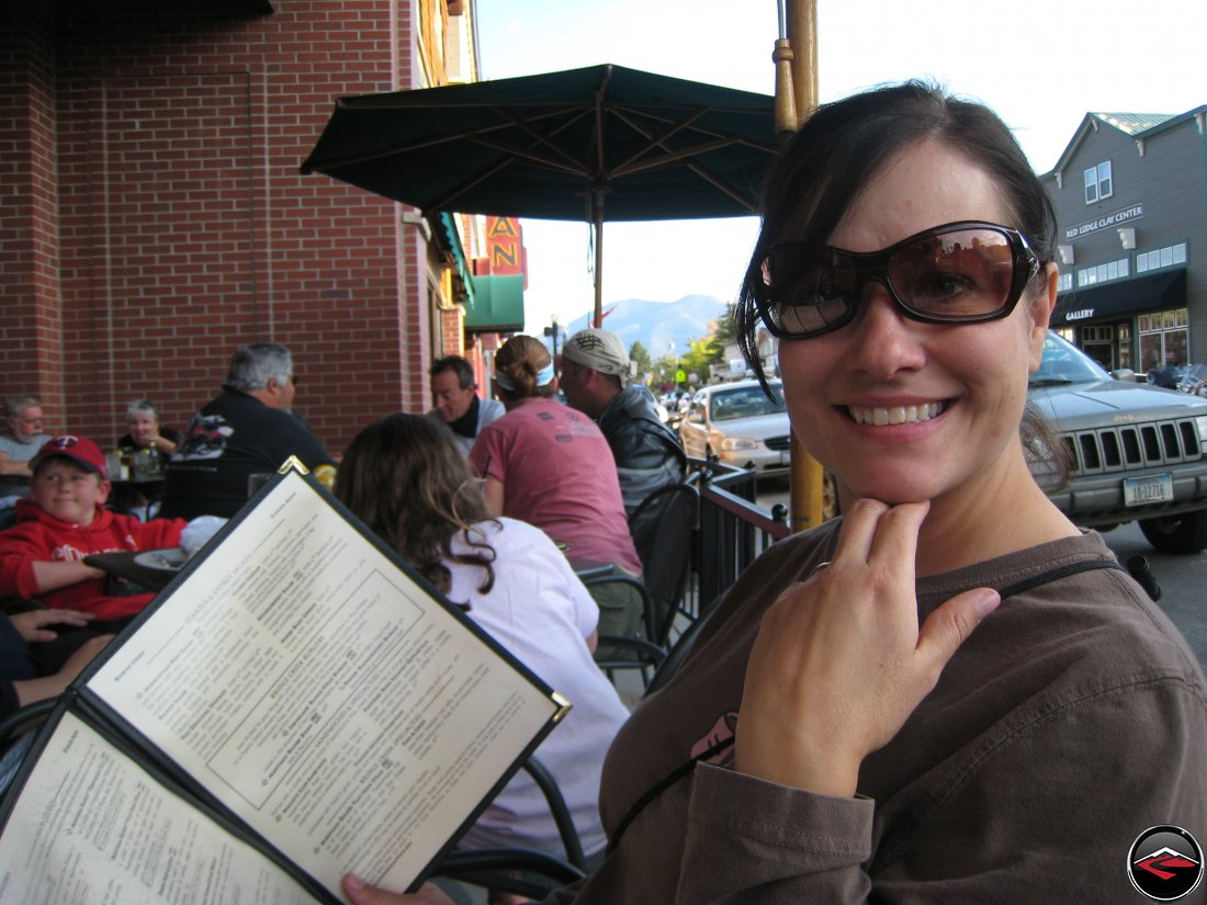 Pretty girl holding a menu in Red Lodge, Montana at the Bridge Creek Country Kitchen and Wine Bar