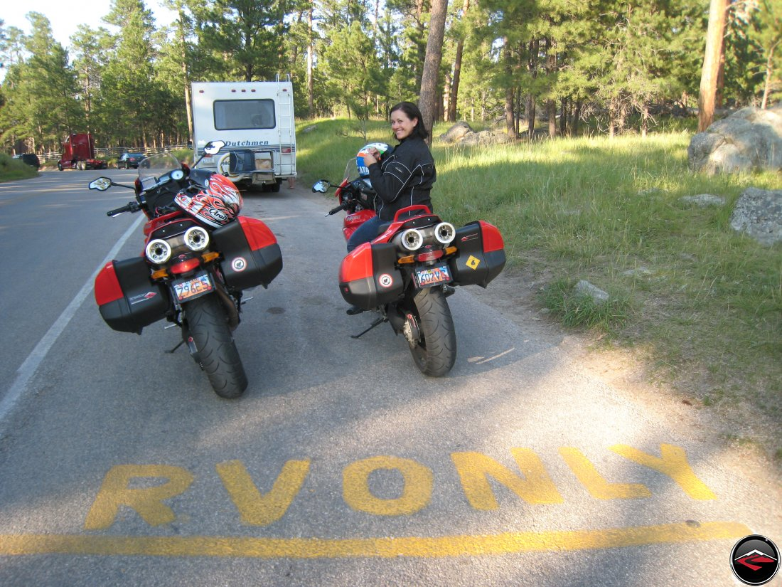 Two motorcycles parked in RV Only Parking