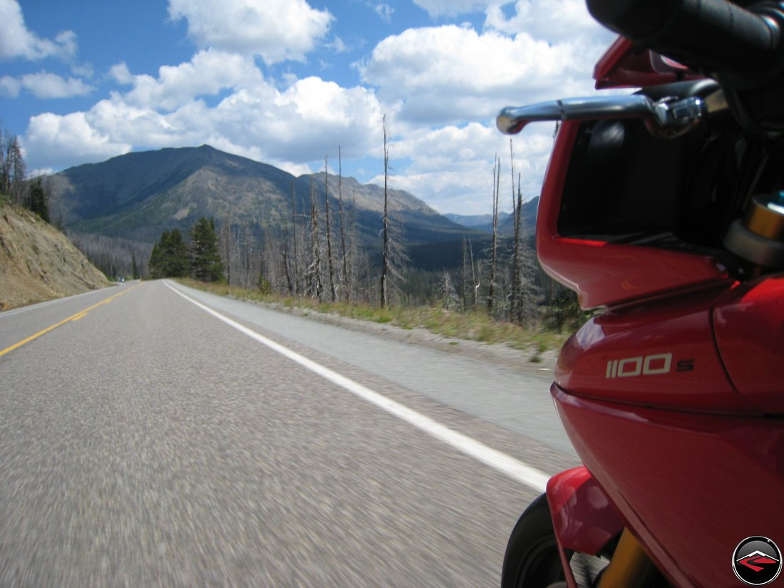 Ducati Multistrada riding out the east gate of Yellowstone National Park
