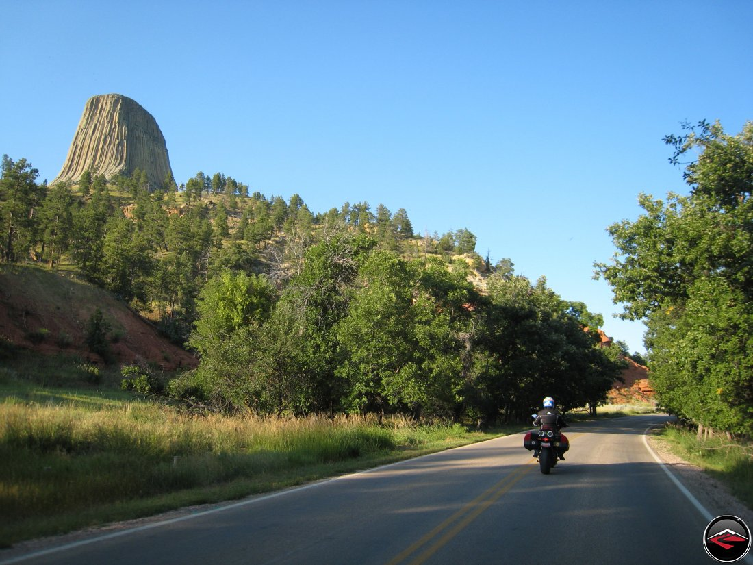 Ducati Multistrada motorcycle riding around Devils Tower at Sunset